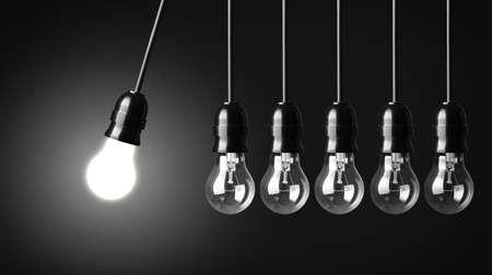 pendulum: Idea concept on black  Perpetual motion with light bulbs Stock Photo