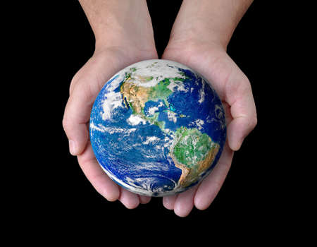 save the planet: Man holding a globe in his hands