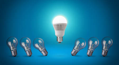 conserve: Row with light bulbs and LED bulb