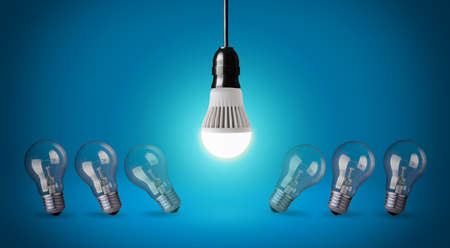Glowing LED bulb and simple light bulbs  Stock Photo