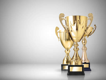 sports trophy: golden trophies on gray background
