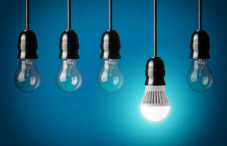 Glowing LED bulb and simple light bulbs Archivio Fotografico