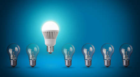 Row with light bulbs and LED bulb  Idea concept on blue background photo