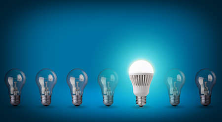 Idea concept on blue background  Row with light bulbs and LED bulb   photo