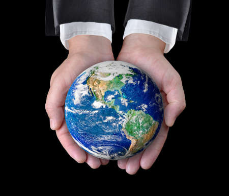 Businessman holding a globe in his hands