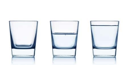 full: Vac�o, medio lleno de agua y vasos aislados en el fondo blanco Foto de archivo