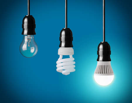 fluorescent: hanging tungsten light bulb, energy saving and LED bulb Stock Photo