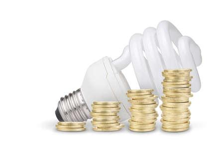 Money saved with energy saver bulb  Isolated on white background photo