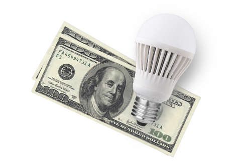 electric bulb: LED bulb over dollar bills isolated on white background
