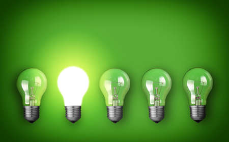 Idea concept with row of light bulbs and glowing bulb Stock Photo