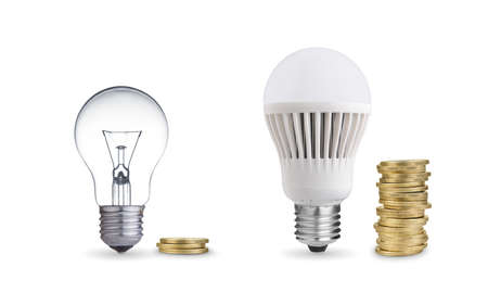 Money saved in different kinds of light bulbs  Isolated on white photo