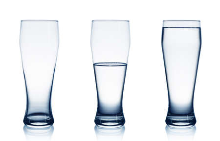 Isolated on white empty, half and full water glasses  photo