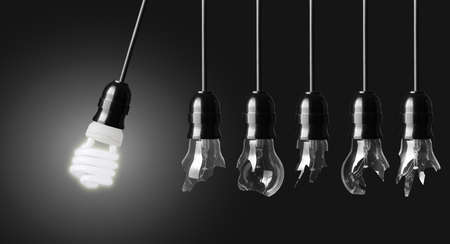 electric bulb: Perpetual motion with broken light bulbs and energy saver bulb Stock Photo