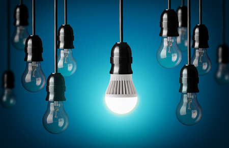 LED bulb and simple light bulbs Blue background  photo