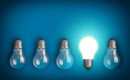 idea: Idea concept with row of light bulbs and glowing bulb Stock Photo