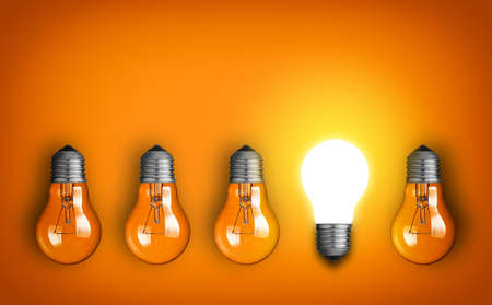 creativity and innovation: Idea concept with row of light bulbs and glowing bulb Stock Photo