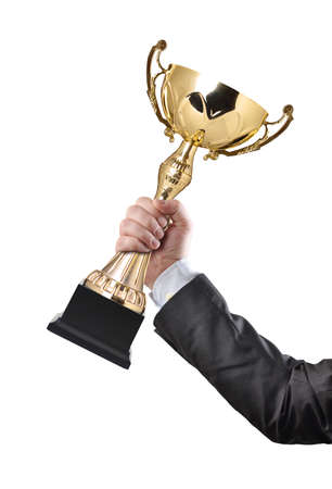 Businessman holding a champion golden trophy on white background  photo
