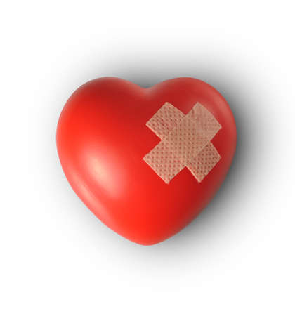 mended: Red heart with plaster, Isolated on white background