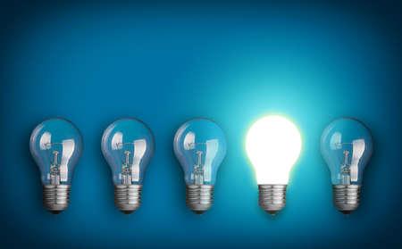 電球と白熱電球の行とアイデア コンセプト 写真素材