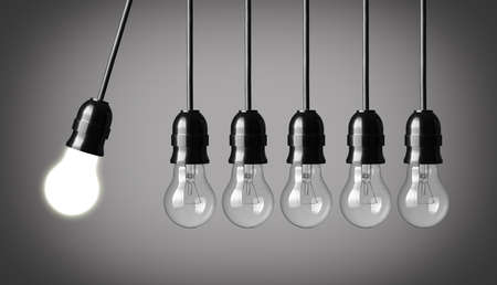 Perpetual motion with light bulbs  Idea concept on gray background