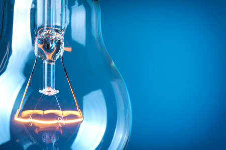innovation technology: Close up glowing light bulb