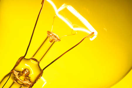idea light bulb: Close up glowing light bulb on yellow background