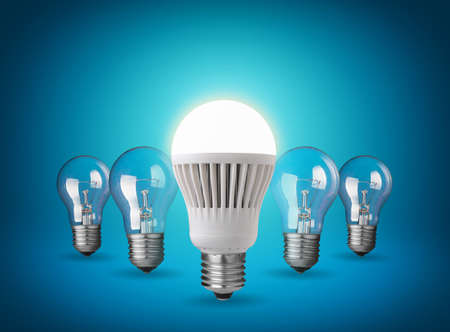 Idea concept with light bulbs on blue background photo