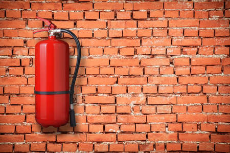 fire extinguisher on brick wall  photo