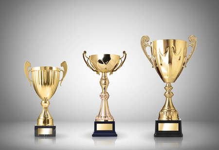 shiny metal background: golden trophies on gray background