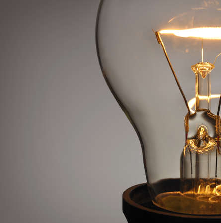 saving electricity: Close up glowing light bulb