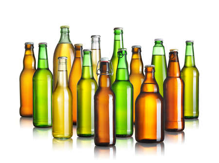 Collection of beer bottles without labels isolated on white