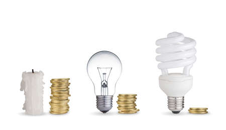 Money spent in different light bulbs and candle.Isolated on white  photo