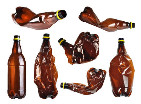 Collection of brown plastic bottles isolated on white  photo