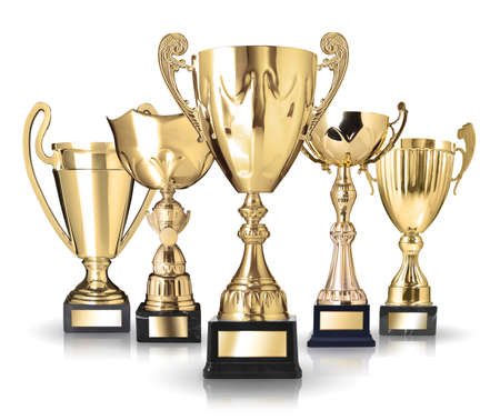 Set of golden trophies. Isolated on white background Stock Photo