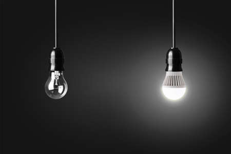incandescent: Light bulb and glowing LED bulb on black