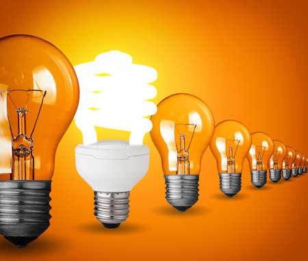 saver: Idea concept with light bulbs on orange background
