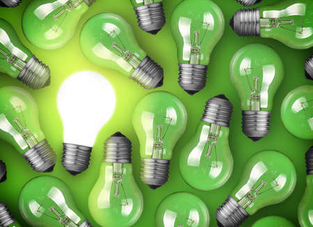 Concept for big idea. Glowing light bulb on green background