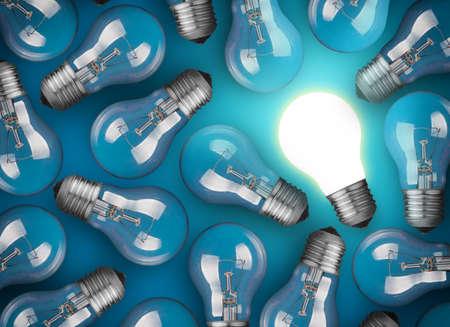 青の背景に電球のアイデア コンセプト