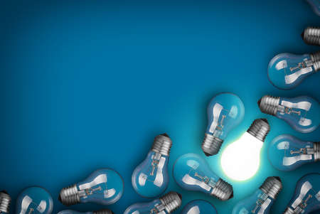 power supply: Idea concept with light bulbs on blue background