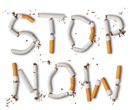 anti tobacco: Text stop now made from broken cigarettes