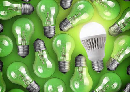 enchufe de luz: Concepto para la gran idea. Lucir bombilla LED en fondo verde Foto de archivo
