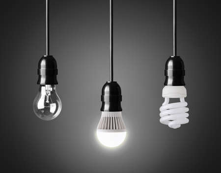lamp light: Light bulb,energy saver bulb and LED bulb on black