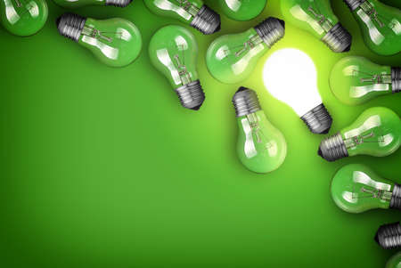 glowing light bulb: Idea concept with light bulbs on green background