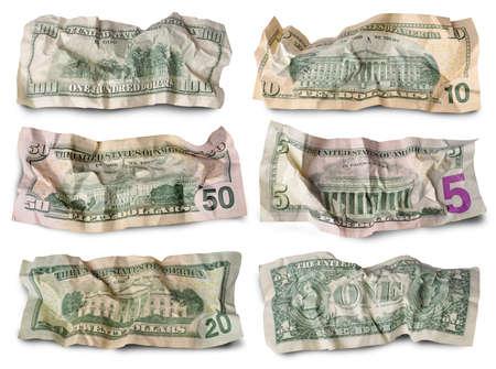 Set of crumpled dollar bills against white background