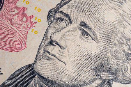 alexander: Macro of Alexander Hamilton portrait on ten dollar bill.
