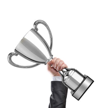 primer lugar: Empresario la celebraci�n de un trofeo copa de plata Foto de archivo