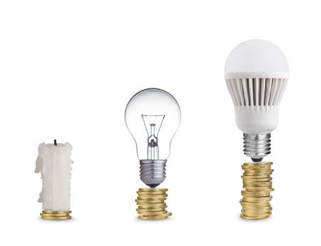 spent: money spent on different light bulbs and candle Stock Photo