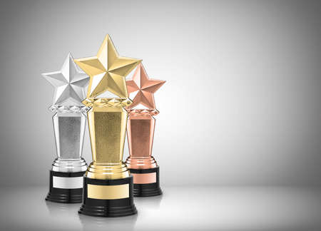 Sterne-Auszeichnungen auf grauem Hintergrund Standard-Bild