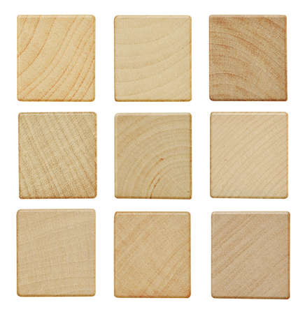 Blank wood scrabble pieces isolated on white background