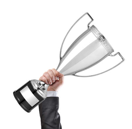 award trophy: Businessman holding silver cup trophy